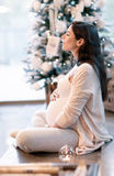 Pregnant woman in Christmastime Royalty Free Stock Photo