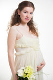 Pregnant woman with chrysanthemums bouquet Stock Photography