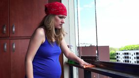 Pregnant woman clean dust at flat house loggia stock video