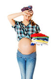 Pregnant woman cleaning. Stock Image