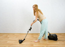 Free Pregnant Woman Cleaning Floor With Vacuum Cleaner Royalty Free Stock Images - 9318249