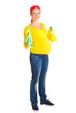Pregnant woman cleaning glass Stock Photography