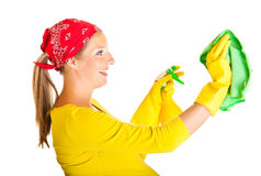 Pregnant woman cleaning glass Royalty Free Stock Photography