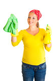Pregnant woman cleaning glass Royalty Free Stock Image