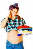 Pregnant woman cleaning at home Royalty Free Stock Photo