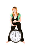 Pregnant woman with a clock Stock Photos