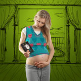 Pregnant woman with clock Royalty Free Stock Photos