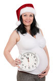 Pregnant woman with clock Royalty Free Stock Photo