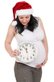 Pregnant woman with clock Royalty Free Stock Image