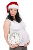 Pregnant woman with clock Stock Photo