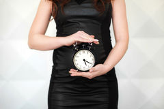 Pregnant woman with clock Stock Images
