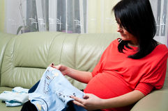Pregnant woman with clothes Royalty Free Stock Image