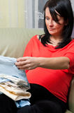 Pregnant woman with clothes Stock Photo