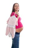 Pregnant woman with clothes Royalty Free Stock Photos