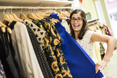 Pregnant woman in clothes store looking some clothes Royalty Free Stock Image