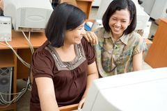 Pregnant woman and colleague chatting Stock Photos