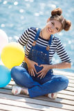 Pregnant woman with colorful balloons on the beach Royalty Free Stock Photography