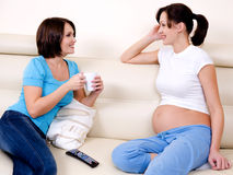 Pregnant woman communicates with the girlfriend Royalty Free Stock Image