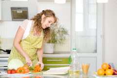 Pregnant woman consulting a recipe Royalty Free Stock Images