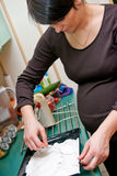 Pregnant woman cooking Royalty Free Stock Photography