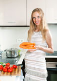 Pregnant woman cooking carrots Stock Image
