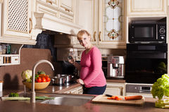 Pregnant woman is cooking Royalty Free Stock Photography