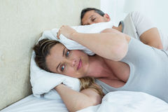 Pregnant woman covering her ears Stock Images