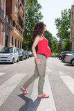 Pregnant woman in crosswalk Stock Photography