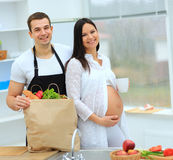 Pregnant woman with a cup in her hand Royalty Free Stock Photo