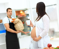 Pregnant woman with a cup in her hands Stock Image