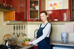 Pregnant woman cutting oranges Stock Photography