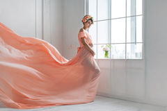 Free Pregnant Woman Dancing In Pink Evening Dress Flying On Wind. Waving Fabric, Fashion Shot. Stock Images - 70940134