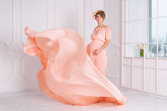 Free Pregnant Woman Dancing In Pink Evening Dress Flying On Wind. Waving Fabric, Fashion Shot. Stock Image - 70940181