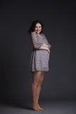 Pregnant woman on dark background Royalty Free Stock Photography