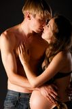 Pregnant woman dark couple kiss 0121(62).jpg Stock Photo