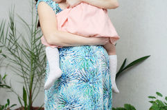 Pregnant woman with daughter, maternal love, pregnancy belly of woman with child. Expecting baby birth in third trimester. Pregnant women with daughter, maternal Royalty Free Stock Image