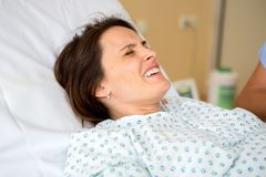 Pregnant woman in delivery room. Having contractions stock image