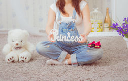 Pregnant woman in denim overalls Royalty Free Stock Photo