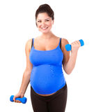 Pregnant woman do exercise royalty free stock image