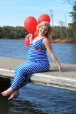 Pregnant Woman on the Dock Stock Photography