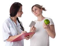 Pregnant woman and doctor. Stock Photos