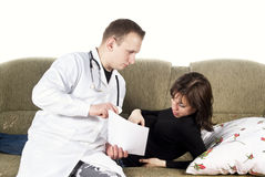 Pregnant woman and the doctor on the couch Stock Photography