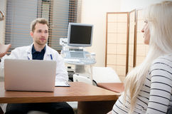 Pregnant woman in doctor`s office. Stock Photos