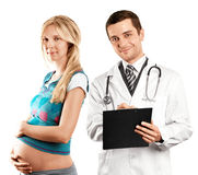 Pregnant Woman With Doctor. Pregnant women with doctor waiting for new life Royalty Free Stock Image