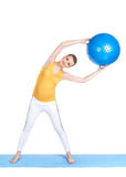 A pregnant woman does gymnastics with ball Stock Photos