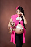 Pregnant woman with dog Stock Photo