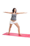 Pregnant woman doing aerobics exercises Stock Image