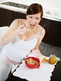 Pregnant woman doing breakfast at home Stock Image