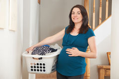 Pregnant Woman Doing Chores At Home stock photo