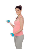 Pregnant woman doing exercise with dumbbells Royalty Free Stock Photos